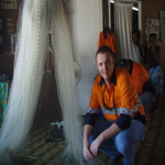 Matt with Lea Lea villagers' fishing net